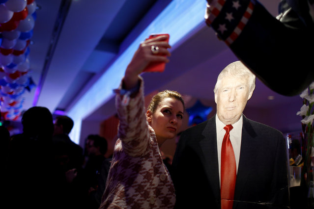 A woman photographs herself with a cardboard figure of U.S. Republican presidential candidate Donald Trump in Berlin, Germany, November 8, 2016. (Photo by Axel Schmidt/Reuters)