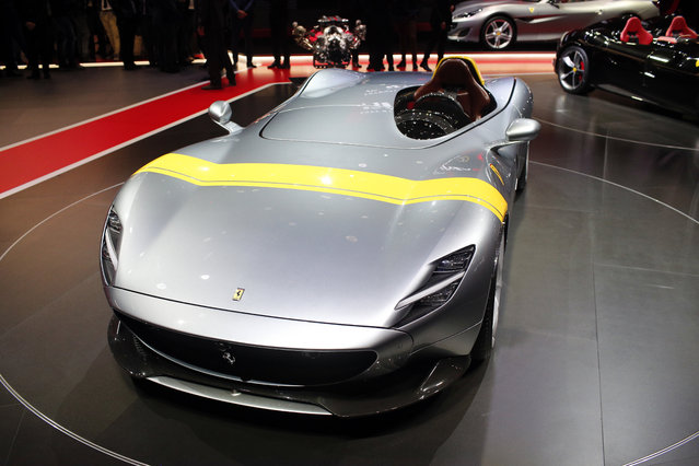 The Ferrari Monza SP1 is on display at the Auto show in Paris, France, Tuesday, October 2, 2018, 2018. Ferrari says its new Monza SP1 and SP2 supercars will cost 1.6 million euros ($1.9 million) each for the 499 people lucky enough to be invited to buy one. (Photo by Thibault Camus/AP Photo)
