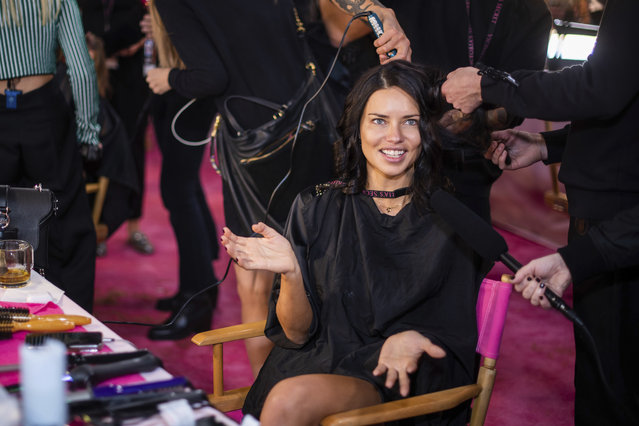 Adriana Lima appears backstage during hair and makeup at the 2018 Victoria's Secret Fashion Show at Pier 94 on Thursday, November 8, 2018, in New York. (Photo by Charles Sykes/Invision/AP Photo)