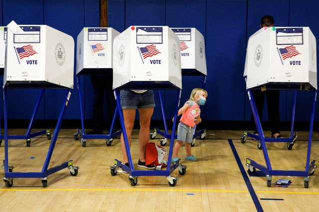 People fill out ballots during voting in the New York mayoral primary election at a polling site in the Brooklyn borough of New York City, New York, U.S., June 22, 2021. (Photo by Brendan McDermid/Reuters)