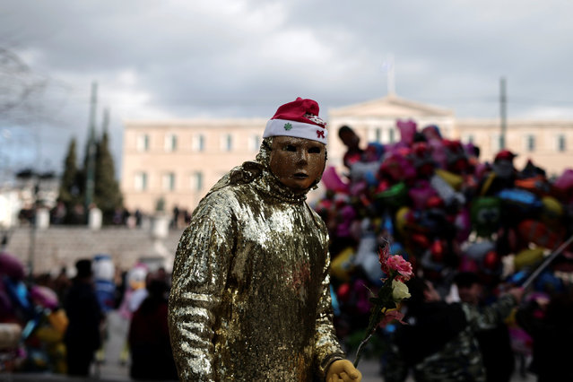 A masked street performer stands on central Syntagma square in Athens, Greece, December 27, 2016. (Photo by Alkis Konstantinidis/Reuters)
