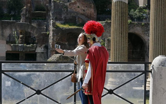 A tourist takes a selfie with a man dressed as a centurion in downtown Rome March 12, 2015. (Photo by Tony Gentile/Reuters)