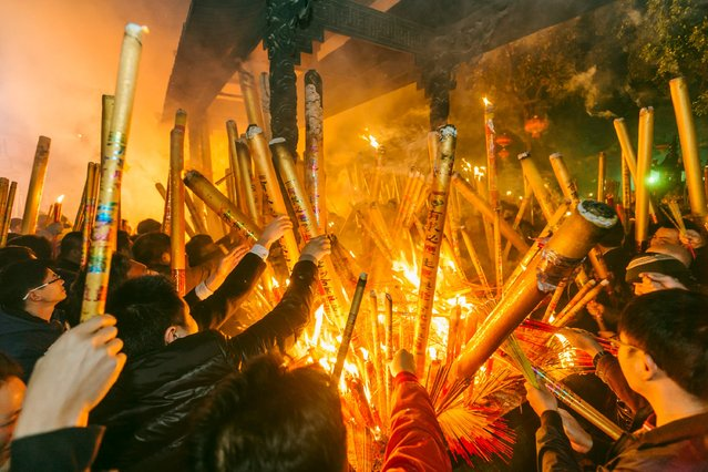 People burn incense as they pray for good fortune at the beginning of the first day of Chinese Lunar New Year, at Yuanmiaoguan temple in Huizhou, Guangdong province, February 8, 2016. (Photo by Reuters/Stringer)