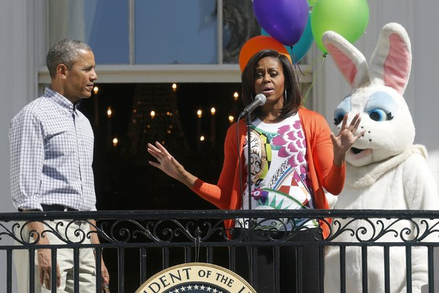 U.S. President Barack Obama (L) and first lady Michelle Obama welcome visitors to the South Lawn for the annual Easter Egg Roll at the White House in Washington April 6, 2015. (Photo by Jonathan Ernst/Reuters)