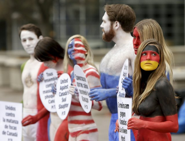 Activists with People for the Ethical Treatment of Animals (PETA), protest against the upcoming commercial seal hunt in Canada in front of the Canadian Embassy in Washington April 10, 2015. (Photo by Gary Cameron/Reuters)
