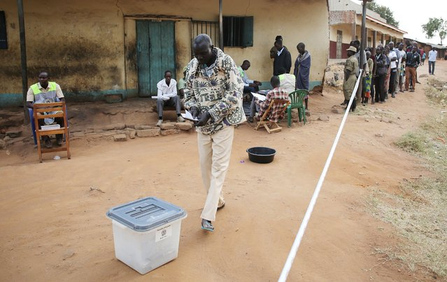 A man casts his ballot in a polling station during elections in Kaabong in Karamoja region, Uganda February 18, 2016. (Photo by Goran Tomasevic/Reuters)