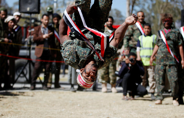 A newly recruited Houthi fighter displays skills during a parade before heading to the frontline to fight against government forces, in Sanaa, Yemen January 12, 2017. (Photo by Khaled Abdullah/Reuters)