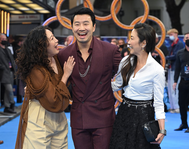 """Actors Sandra Oh, Simu Liu and Michelle Yeoh attend the UK premiere of """"Shang-Chi and the Legend of the Ten Rings"""" at The Curzon Mayfair on August 26, 2021 in London, England. (Photo by Karwai Tang/WireImage)"""