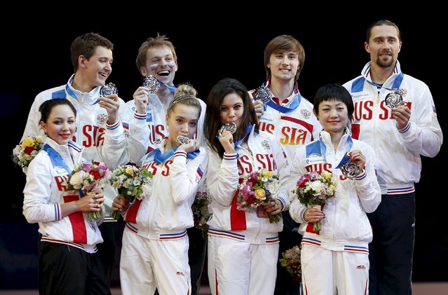 Team Russia pose with their silver medals on the podium during a medal ceremony at the ISU World Team Trophy in Figure Skating in Tokyo April 18, 2015. (Photo by Yuya Shino/Reuters)
