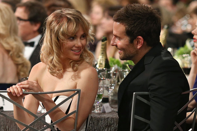 Actor Bradley Cooper (R) and model Suki Waterhouse attend 20th Annual Screen Actors Guild Awards at The Shrine Auditorium on January 18, 2014 in Hollywood, California. (Photo by Christopher Polk/WireImage)