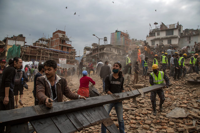 Emergency rescue workers clear debris in Basantapur Durbar Square while searching for survivors on April 25, 2015 in Kathmandu, Nepal. (Photo by Omar Havana/Getty Images)