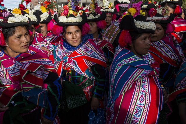 In this January 29, 2017 photo, dancers wait their turn to perform during Virgin of Candelaria celebrations in Puno, Peru. In addition to devotion, villagers have other reasons for dancing on the feast. Some are grateful to have been cured of disease, while others are asking for protection for their crops, or increased political power. (Photo by Rodrigo Abd/AP Photo)