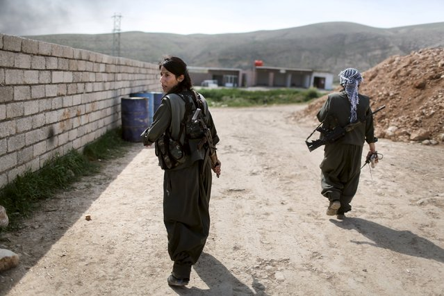 Female Kurdistan Workers Party (PKK) fighters leave to join others at a position which had been hit by Islamic State car bombs in Sinjar, March 11, 2015. (Photo by Asmaa Waguih/Reuters)