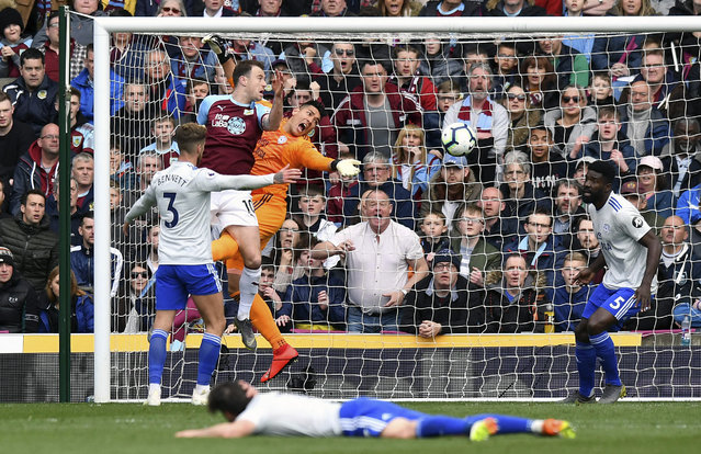 Cardiff City goalkeeper Neil Etheridge drops the ball under pressure from Burnley's Ashley Barnes during the English Premier League soccer match between Burnley and Cardiff Ciry at Turf Moor, IN Burnley, England, Saturday, April 13, 2019. (Photo by Anthony Devlin/PA Wire via AP Photo)