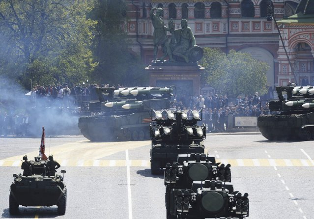 Russian BUK-M2/SA-17 Grizzly medium-range battlefield surface-to-air missile system drives during the Victory Day parade at Red Square in Moscow, Russia, May 9, 2015. (Photo by Reuters/Host Photo Agency/RIA Novosti)