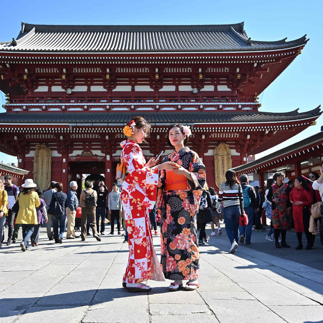 Women wearing kimonos stand on the grounds of Sensoji temple in Tokyo's Asakusa district on April 16, 2019. (Photo by Charly Triballeau/AFP Photo)