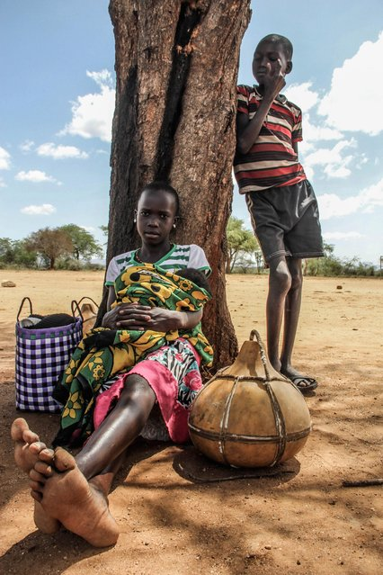 Children often look after their younger siblings while the parents are away working, Karamoja, Uganda, February, 2017. (Photo by Sumy Sadurni/Barcroft Images)