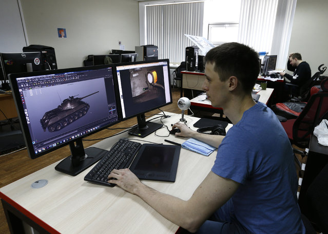 Programmer of Game Stream company, branch of  Wargaming, Andrey Safronov, works on a computer in Minsk, Belarus March 18, 2016. (Photo by Vasily Fedosenko/Reuters)