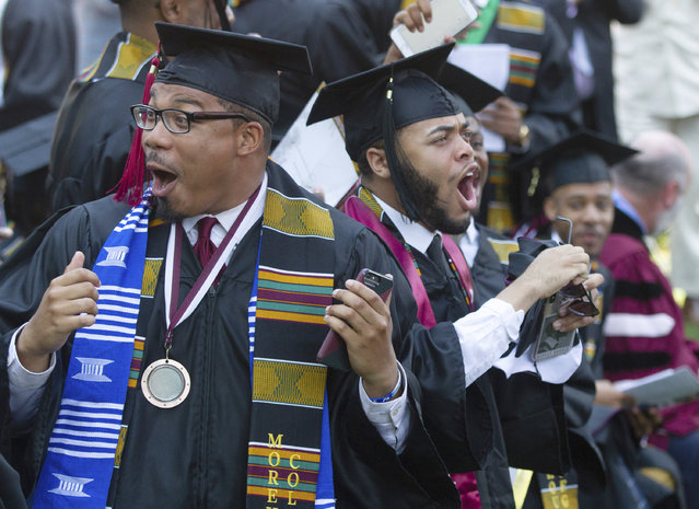 Graduates react after hearing billionaire technology investor and philanthropist Robert F. Smith say he will provide grants to wipe out the student debt of the entire 2019 graduating class at Morehouse College in Atlanta, Sunday, May 19, 2019. (Photo by Steve Schaefer/Atlanta Journal-Constitution via AP Photo)