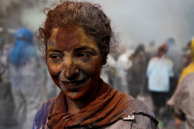 """A reveller celebrates """"Ash Monday"""" by participating in a colourful """"flour war"""", a traditional festivity marking the end of the carnival season and the start of the 40-day Lent period until the Orthodox Easter,in the port town of Galaxidi, Greece, February 27, 2017. (Photo by Alkis Konstantinidis/Reuters)"""