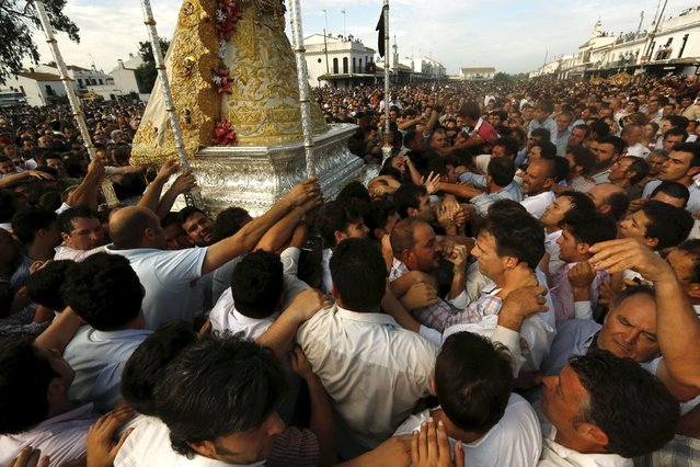 The Virgin of El Rocio is carried by pilgrims during a procession around the shrine of El Rocio in Almonte, southern Spain, May 25, 2015. (Photo by Marcelo del Pozo/Reuters)