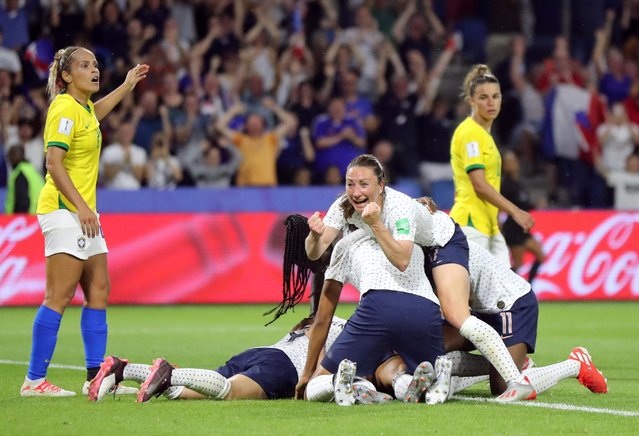 French players celebrate at the end of the France 2019 Women's World Cup round of sixteen football match between France and Brazil, on June 23, 2019, at the Oceane stadium in Le Havre, north western France. (Photo by Lucy Nicholson/Reuters)