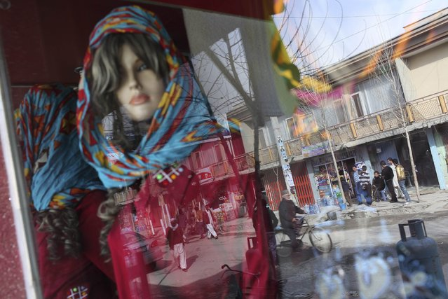 A mannequin is displayed in a shop window in Kabul March 9, 2014. (Photo by Morteza Nikoubazl/Reuters)