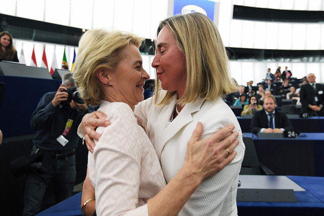Newly elected European Commission President Ursula von der Leyen is congratulated by European Union High Representative for Foreign Affairs and Security Policy Federica Mogherini (R) after a vote on her election at the European Parliament in Strasbourg, eastern France on July 16, 2019. German defence minister Ursula von der Leyen was narrowly elected president of the European Commission on July 16, after winning over sceptical lawmakers. The 60-year-old conservative was nominated to become the first woman in Brussels' top job last month by the leaders of the bloc's 28 member states, to the annoyance of many MEPs. (Photo by Frederick Florin/AFP Photo)