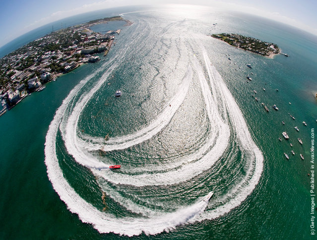 Offshore powerboats make the turn in Key West Harbor during the first of three race days at the Key West World Championship