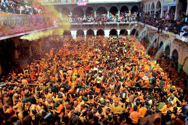 Devotees playing Huranga at Dauji temple near Mathura on Tuesday, March 14, 2017, a day after Holi in which women tear the shirts of men. (Photo by Press Trust of India)