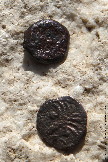 Two ancient bronze coins, which according to Israel Antiquities Authority archaeologists were struck by the Roman procurator of Judea, Valerius Gratus, in the year 17/18 CE and recently were revealed in excavations beneath the Western Wall in Jerusalem's Old City