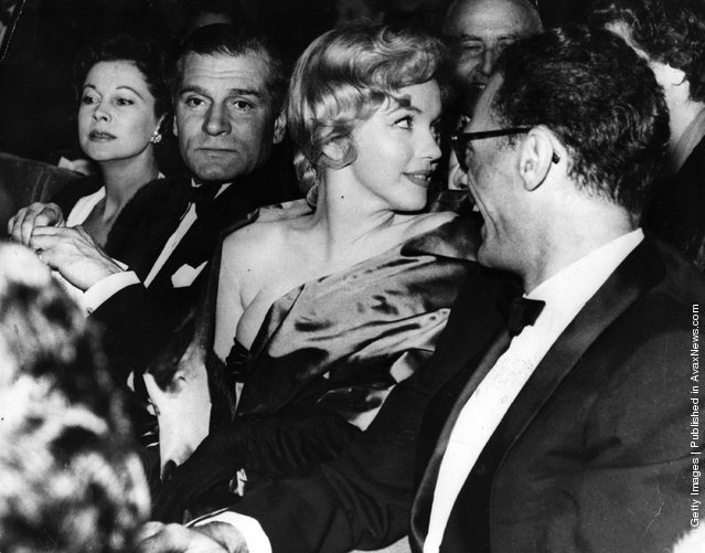 11th October 1956: American actress Marilyn Monroe (1926 - 1962) with her husband playwright Arthur Miller at the first night of his play 'A View From The Bridge', with Sir Laurence Olivier and his wife Vivien Leigh