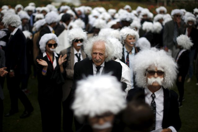 Benny Wasserman, 81, (C) stands with other people dressed as Albert Einstein as they gather to establish a Guinness world record for the largest Einstein gathering, to raise money for School on Wheels and homeless children's education, in Los Angeles, California, United States, June 27, 2015. (Photo by Lucy Nicholson/Reuters)