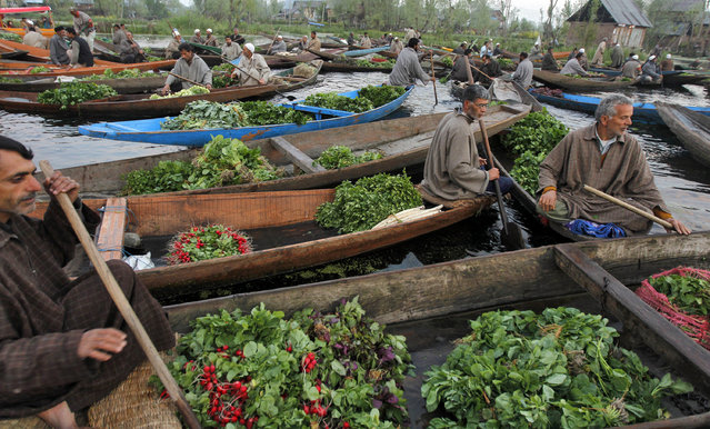 Kashmiri vegetable vendors assemble at a floating market in the interiors of the Dal Lake in Srinagar April 17, 2012. (Photo by Danish Ismail/Reuters)