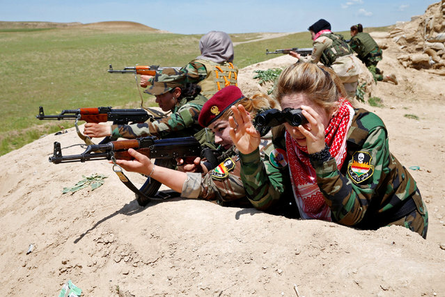 Iraqi Kurdish female fighter Haseba Nauzad (2nd R), 24, and Yazidi female fighter Asema Dahir (3rd R), 21, aim their weapon during a deployment near the frontline of the fight against Islamic State militants in Nawaran near Mosul, Iraq, April 20, 2016. (Photo by Ahmed Jadallah/Reuters)