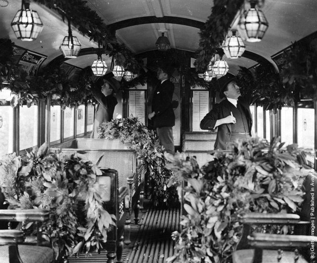 1922: The interior of a tube train decorated with foliage for the Christmas Season
