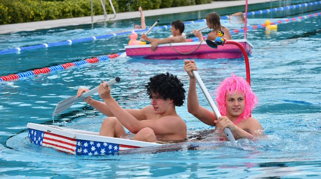 15-year-old Marvin Eck (L-R) and Jannes Richter paddle across the swimming pool during the qualifying race for the first world championships in bathtub racing, in Erfurt, Germany, 09 July 2015. The winner of the race in Erfurt may take part in the international final held on 21 November in Duesseldorf, Germany. (Photo by Martin Schutt/EPA)