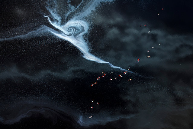 To the Lightning by Hao Jiang, USA: a flock of flamingos fly over the colorful salt lake, the floating foam pattern looks like lightning on lake Magadi in Kenya. Second place – water. (Photo by Hao Jiang/The Nature Conservancy Global Photo Contest 2019)