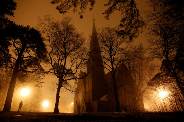 A view through mist shows the Kirk of Saint Mary Magdalene in Primorsk, Leningrad Region, Russia on March 24, 2019. (Photo by Anton Vaganov/Reuters)