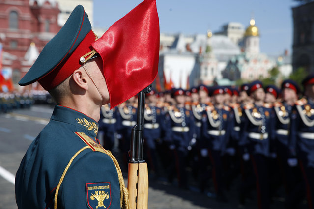 Russian troops march during a Victory Day parade, which commemorates the 1945 defeat of Nazi Germany, at Red Square in Moscow, Russia, Friday, May 9, 2014. Russia marked the Victory Day on May 9 holding a military parade at Red Square. (Photo by Pavel Golovkin/AP Photo)