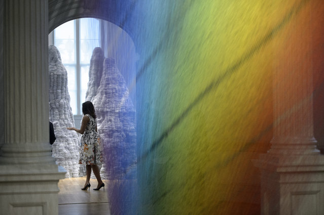 US First Lady Michelle Obama is seen through Gabriel Dawe's Plexus A1 at the Smithsonian's Renwick Gallery on May 13, 2016 in Washington, DC. (Photo by Brendan Smialowski/AFP Photo)