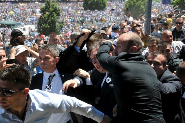 Bodyguards protect Serbia's Prime Minister Aleksandar Vucic during unrest at a ceremony marking the 20th anniversary of the Srebrenica massacre, in Potocari, near Srebrenica, Bosnia and Herzegovina July 11, 2015. (Photo by Ivan Sebalj/Reuters/Avaz)