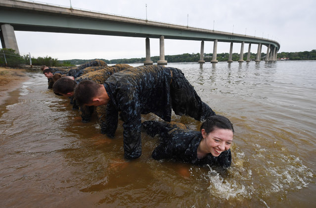 "United States Naval Academy plebe, Kelsey Melinosky takes part in the ""Wet and Sandy"" portion of Sea Trials at the United States Naval Academy on Tuesday May 17, 2016 in Annapolis, MD. (Photo by Matt McClain/The Washington Post)"