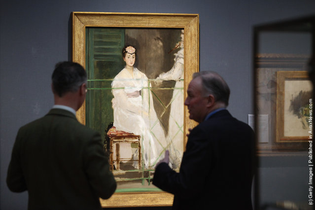 Dr. Christopher Brown (R), the Director of the Ashmolean, talks with Colin Harrison, the Ashmolean's Senior Curator of European Art, in front of a painting by Edouard Manet entitled 'Portrait of Mademoiselle Claus' from 1868 in the Ashmolean Museum