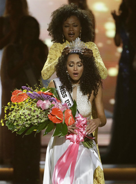 Miss District of Columbia USA Kara McCullough reacts as she is crowned the new Miss USA by former Miss USA Deshauna Barber during the Miss USA contest Sunday, May 14, 2017, in Las Vegas. (Photo by John Locher/AP Photo)