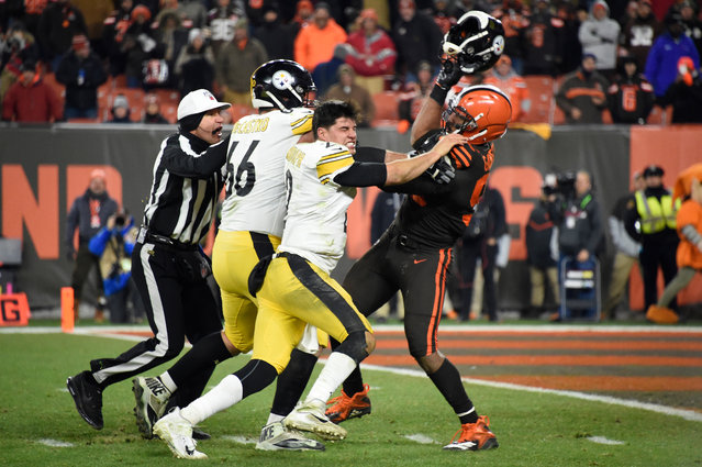 Quarterback Mason Rudolph #2 of the Pittsburgh Steelers fights with defensive end Myles Garrett #95 of the Cleveland Browns during the second half at FirstEnergy Stadium on November 14, 2019 in Cleveland, Ohio. The Browns defeated the Steelers 21-7. (Photo by Jason Miller/Getty Images)