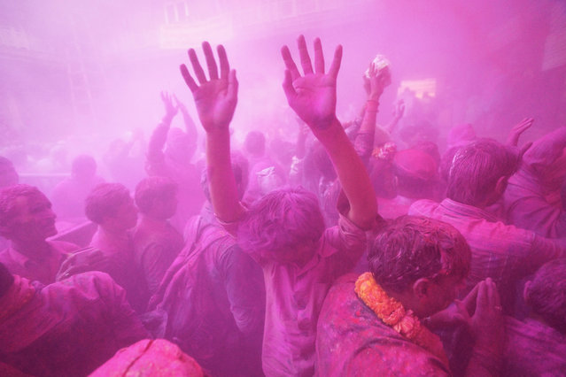 """""""Holi Festival"""". Taken in Vrindavan, India, Indian pray, dance and sing during the Holi Festival, and the color powder flowing in whole city. Photo location: Vrindavan, India. (Photo and caption by Chan Kwok Hung/National Geographic Photo Contest)"""