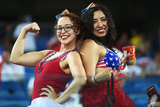 US fans cheer before a Group G football match between Ghana and US at the Dunas Arena in Natal during the 2014 FIFA World Cup on June 16, 2014. (Photo by Javier Soriano/AFP Photo)