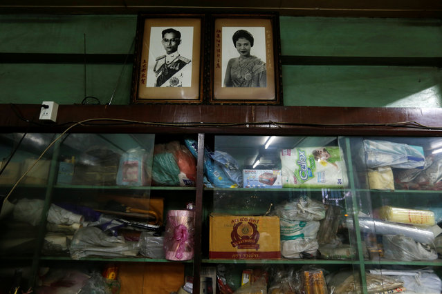 Pictures of Thailand's King Bhumibol Adulyadej and Queen Sirikit hang at a store in Bangkok, Thailand, June 4, 2016. (Photo by Jorge Silva/Reuters)
