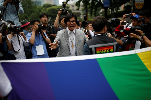A Christian man (C) who opposes homosexuality tries to stop a march during the Korea Queer Culture Festival 2016 in central Seoul, South Korea, June 11, 2016. (Photo by Kim Hong-Ji/Reuters)